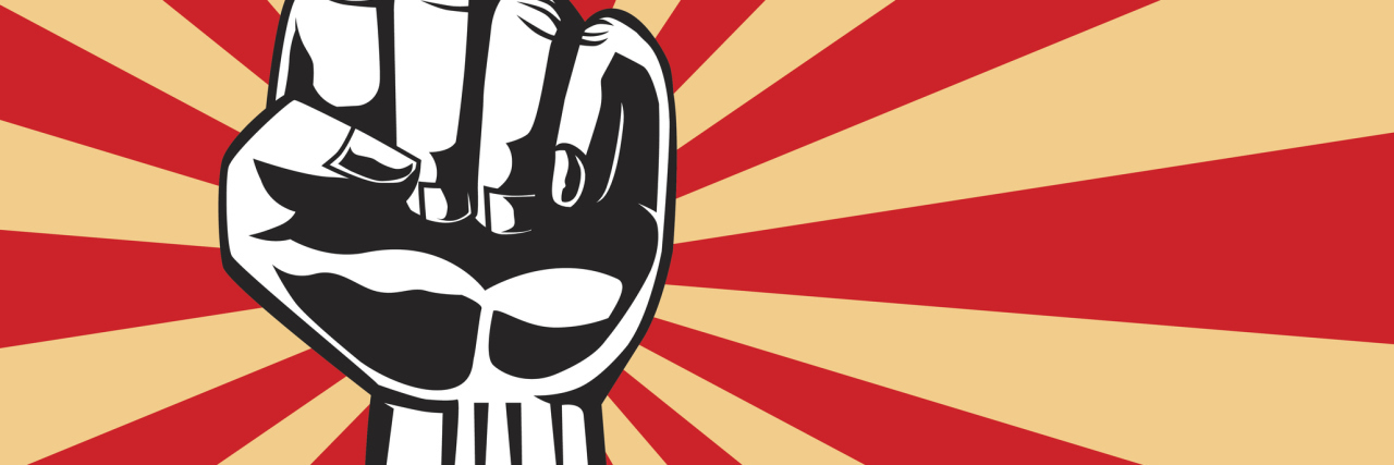 fist of revolution against striped background
