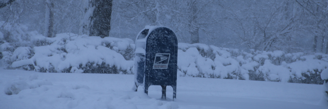 Postal Mailbox in snowstorm