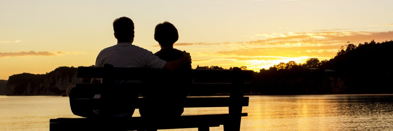 Couple watching a beautiful sunset together.
