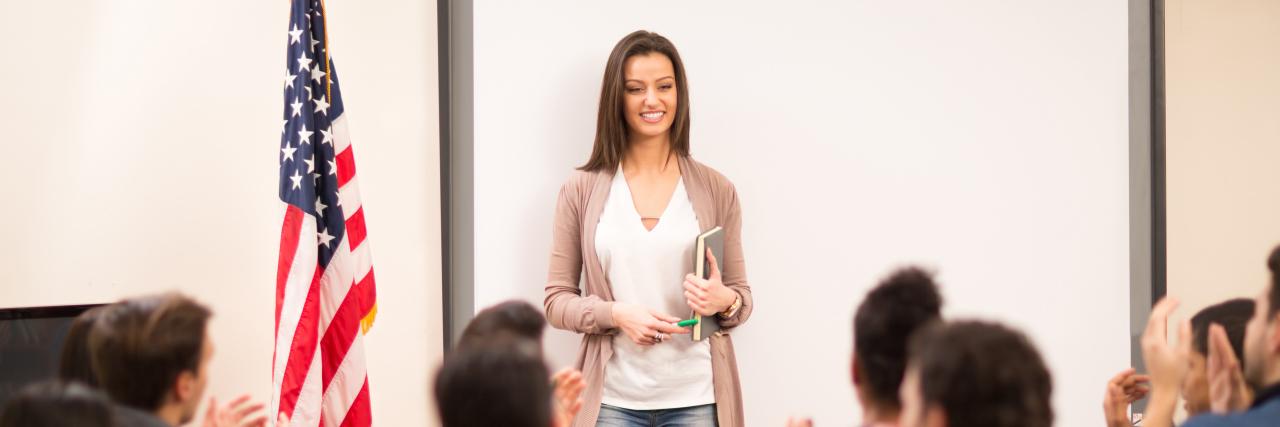 Teacher in university class.