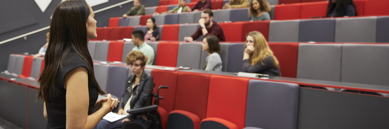 Students in university lecture hall.