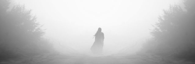 Mysterious woman in fog.