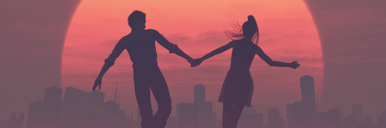 vector illustration of silhouettes of romantic couple against sunset
