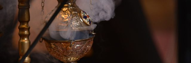 Smoke from incense at Christian church.