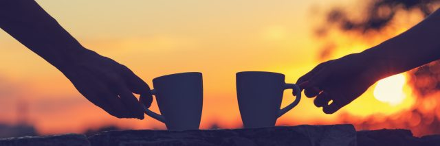 Friends drinking coffee at sunset / sunrise.