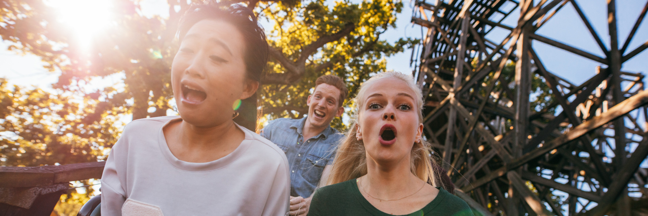 People on a roller coaster.