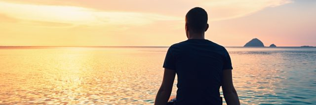 Man thinking at sunset.