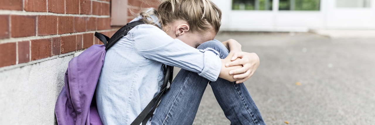 young girl preteen outside school