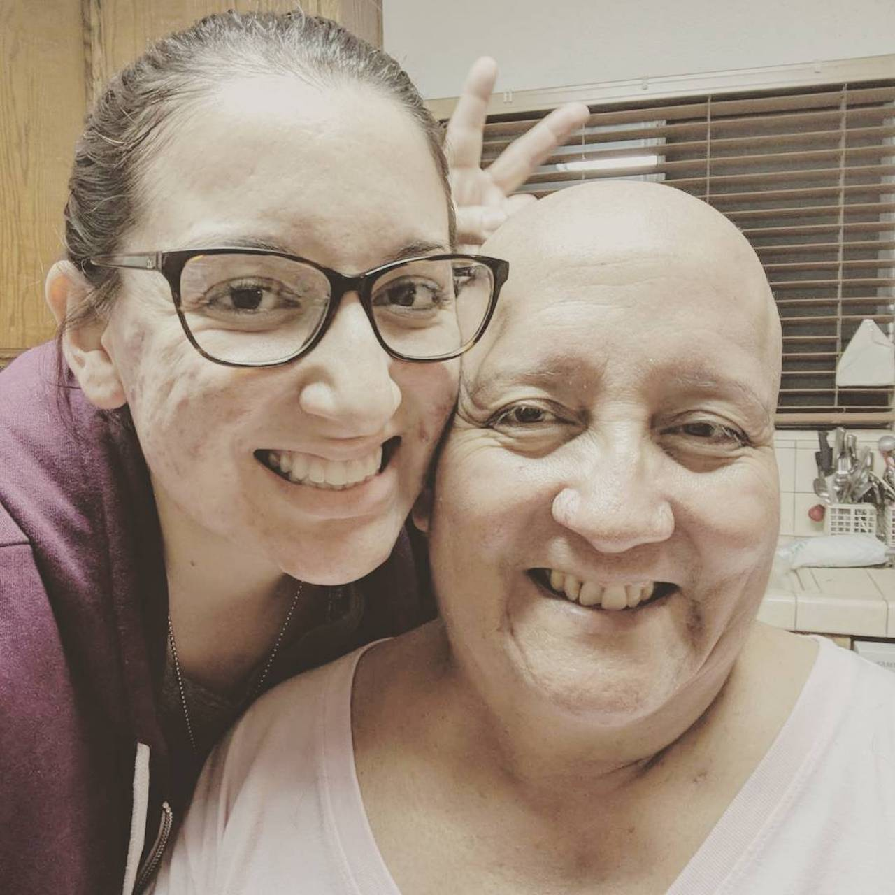 daughter and mom after shaving her head