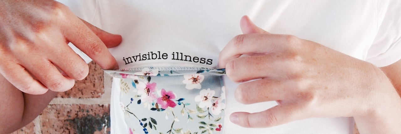 """""""invisible"""" tee with message under floral breast pocket"""