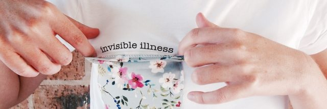 """invisible"" tee with message under floral breast pocket"