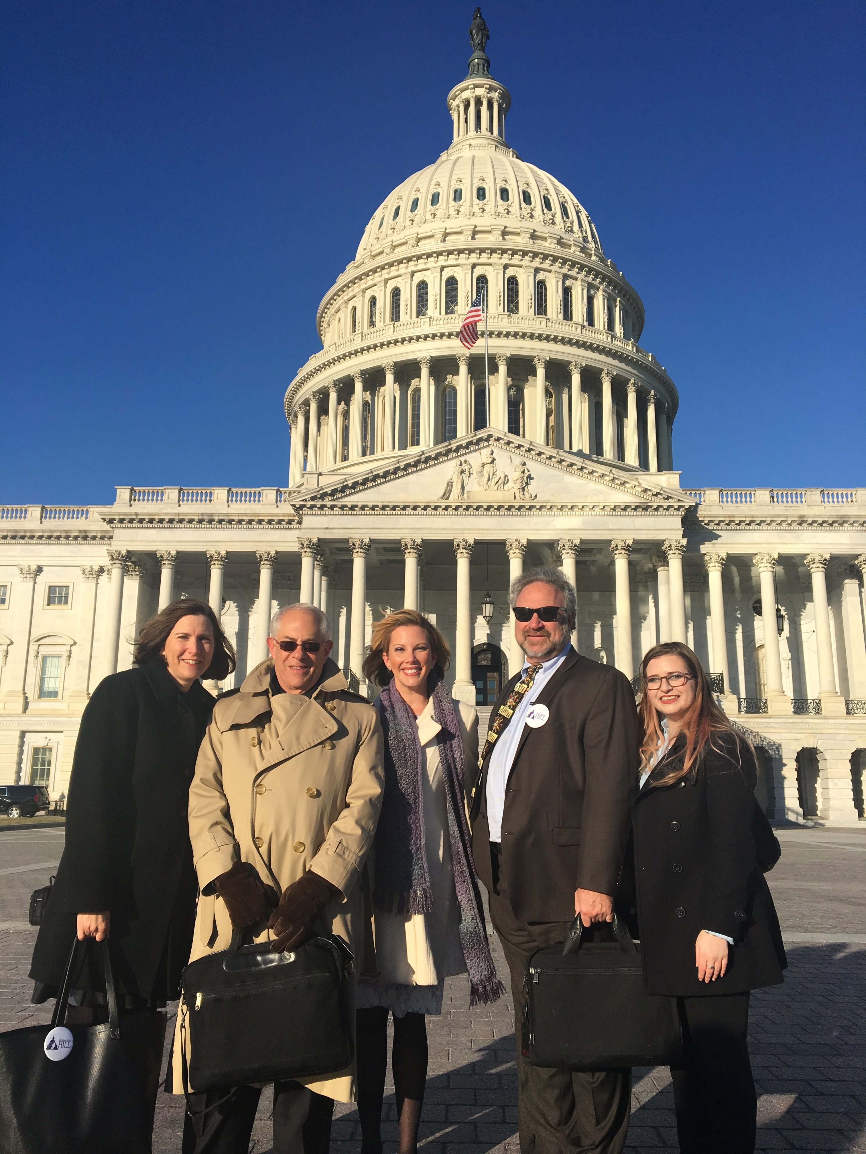 Angelica Heidi Brehm with Dr. Rapoport, Katie Golden, Dr. Cowan, and Ellie Donner-Klein in front of the U.S. Capitol.
