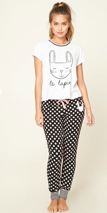 black and whtite polka dot pajama pants and white t shirt with drawing of cat and words le lapin