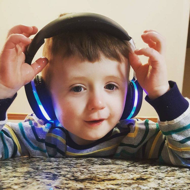 silas smiling with headphones on