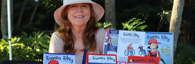 April M. Whitt with her Romeo Riley books.