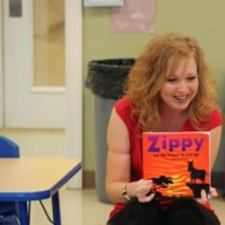 """author reading a book entitled """"Zippy"""" to others"""