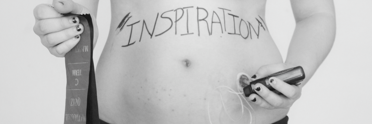 black and white photo of a woman standing in her underwear giving herself an injection in her stomach with the word 'inspiration' written across her abdomen