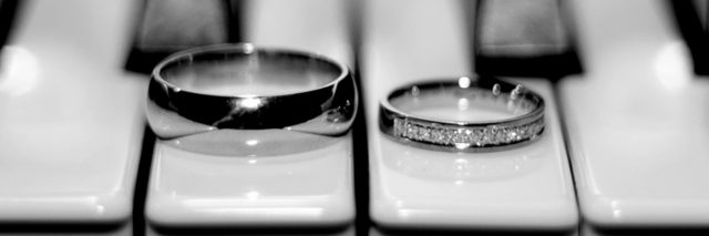 Wedding rings on a piano.
