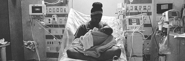 mom holding her baby in a hospital bed