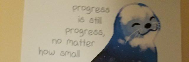picture of a seal with progress quote