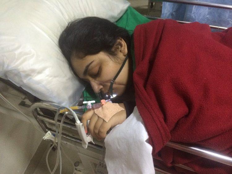 woman lying in a hospital bed sleeping