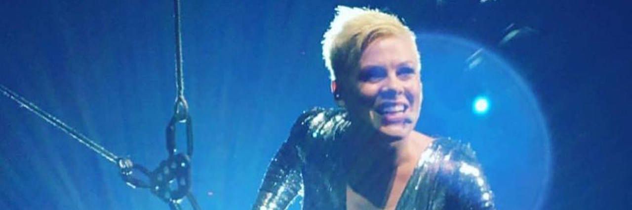 P!nk performing in concert.