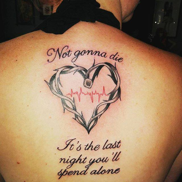 a back tattoo of a heart