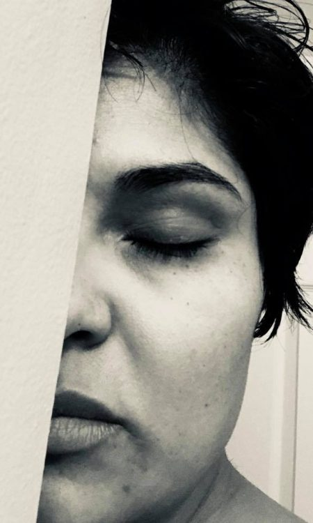 black and white photo of woman's face closing eyes