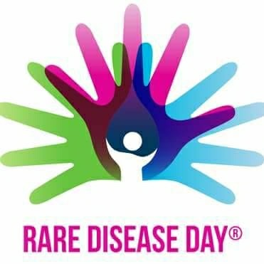 World Rare Disease Day logo with different colored hands interlocking