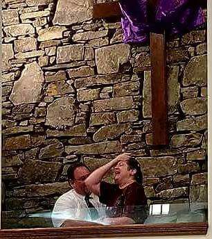 woman getting baptized at her church