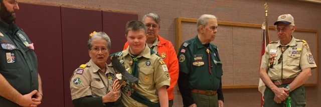 Logan Blythe with local Scout leaders accepting his project for Eagle Scout