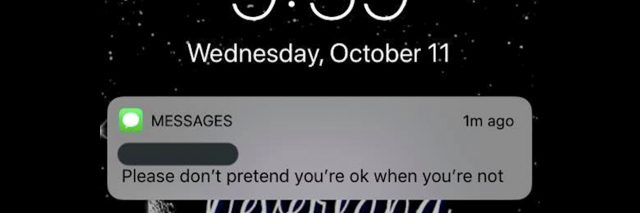 A text message that reads: Please don't pretend you're ok when you're not.