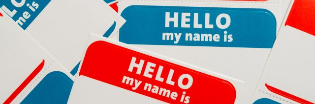 a stack of red and blue 'hello, my name is' stickers