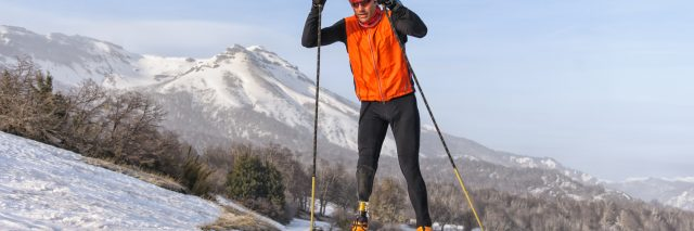 Man with prosthetic leg skiing.