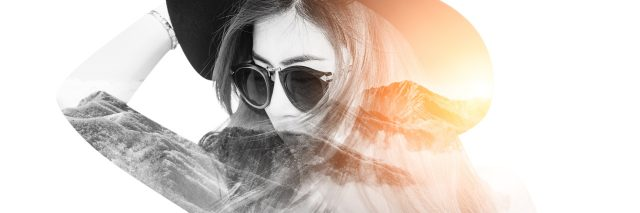 double exposure of a woman wearing a hat and sunglasses and a sunny mountain range