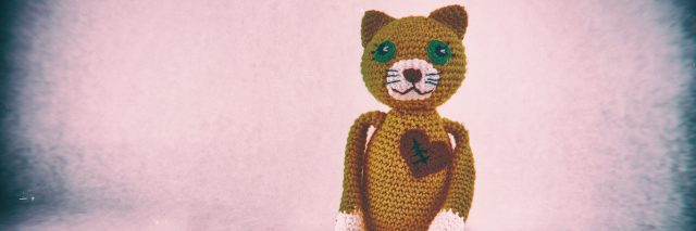 Stuffed cat with a scar across the heart, symbol of heart surgery.