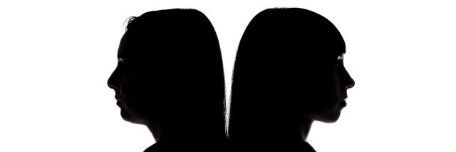 Silhouette of women standing back to back on white background