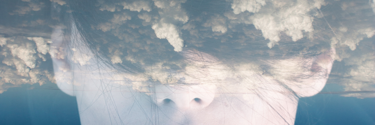 double exposure picture of a woman with clouds across her eyes