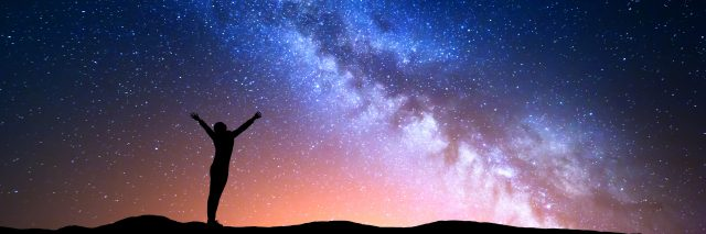 Woman reaching for the stars.
