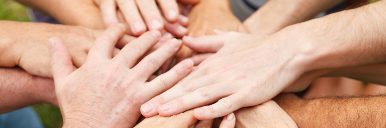 Human hands showing unity.