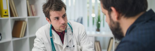 young doctor talking with a male patient