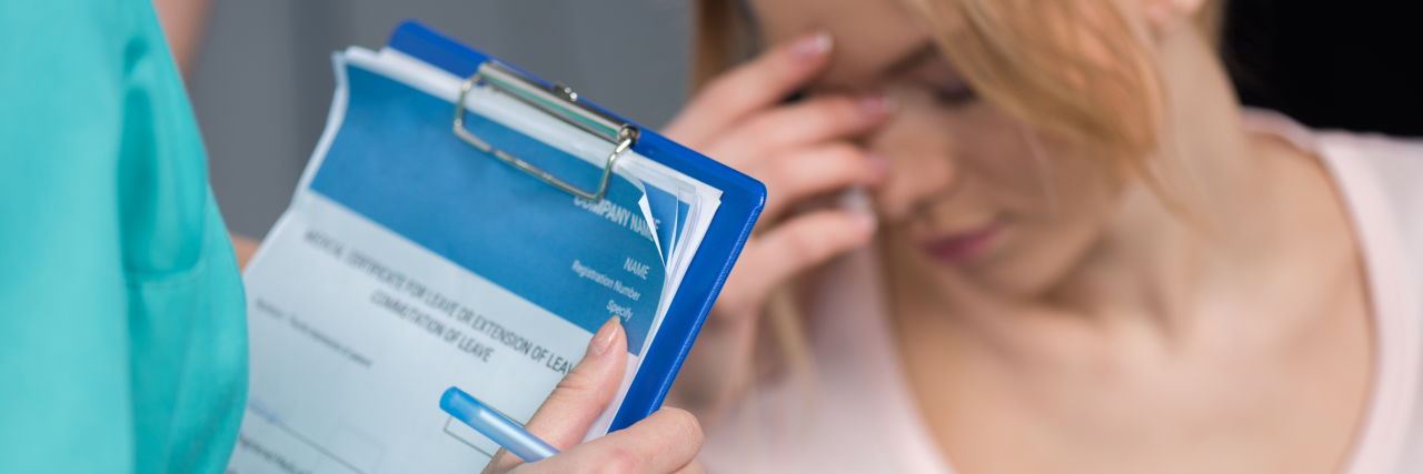 Cropped shot of nurse holding clipboard and pen while upset patient sitting behind