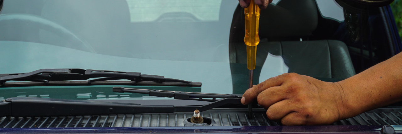 Repairing car windshield.