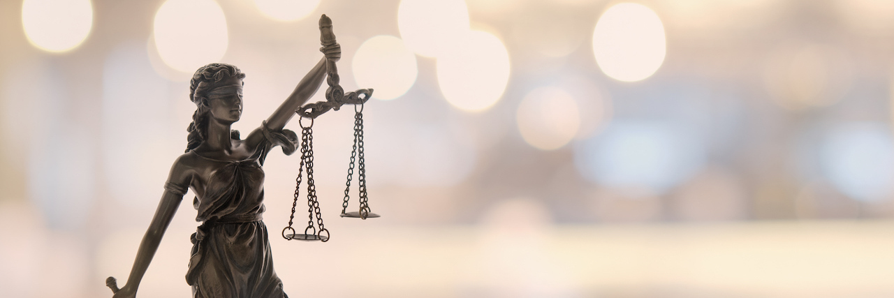 Status of the lady of justice, balancing the scales in her hands