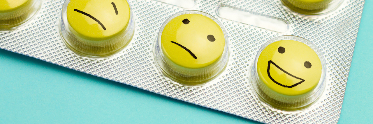 a packet of pills with faces written on them
