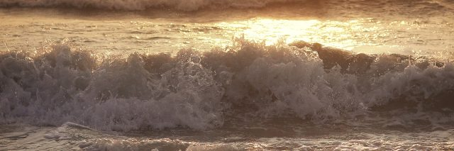 Rough waves with view of sunset.