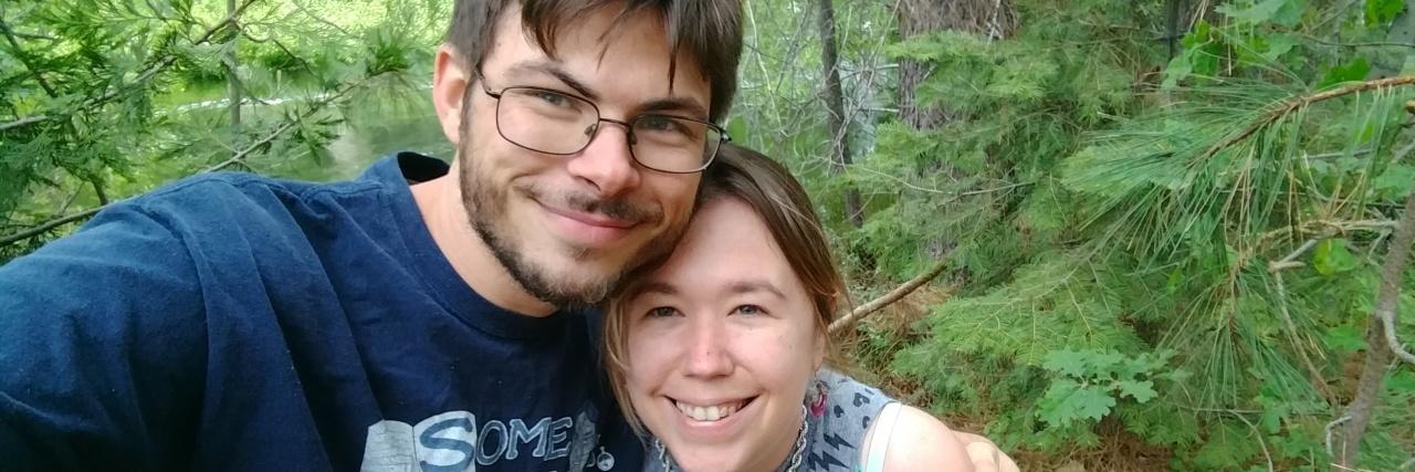 Kourtnie and her fiance outside.