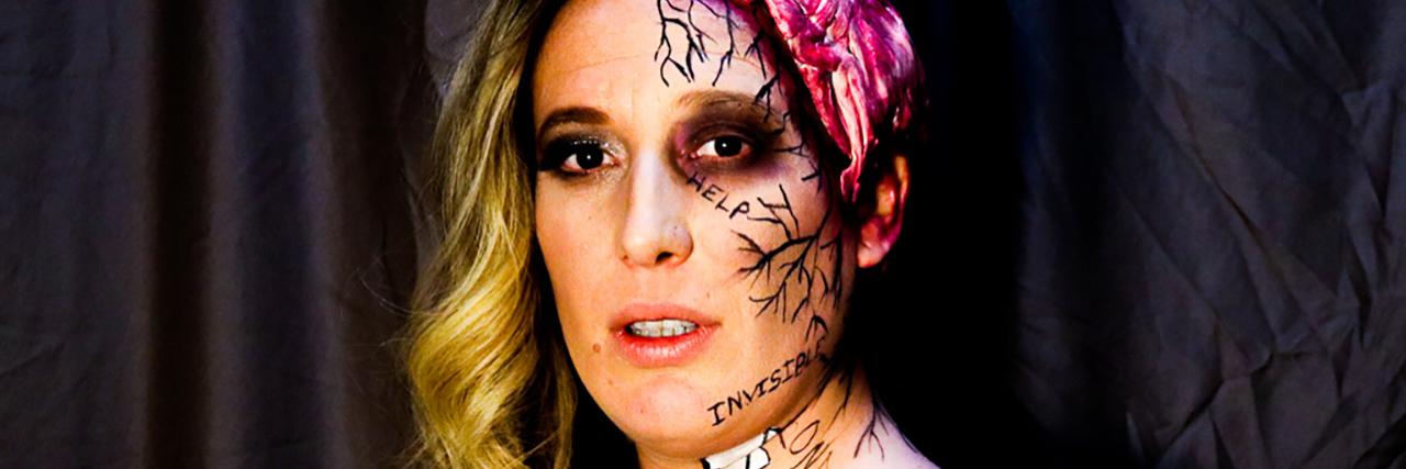 Nikki Stang wearing makeup to visualize her traumatic brain injury.