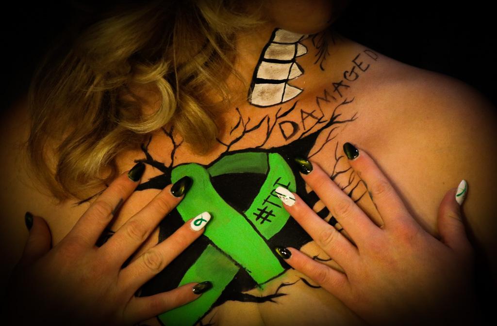 Nikki with brain injury awareness ribbon.