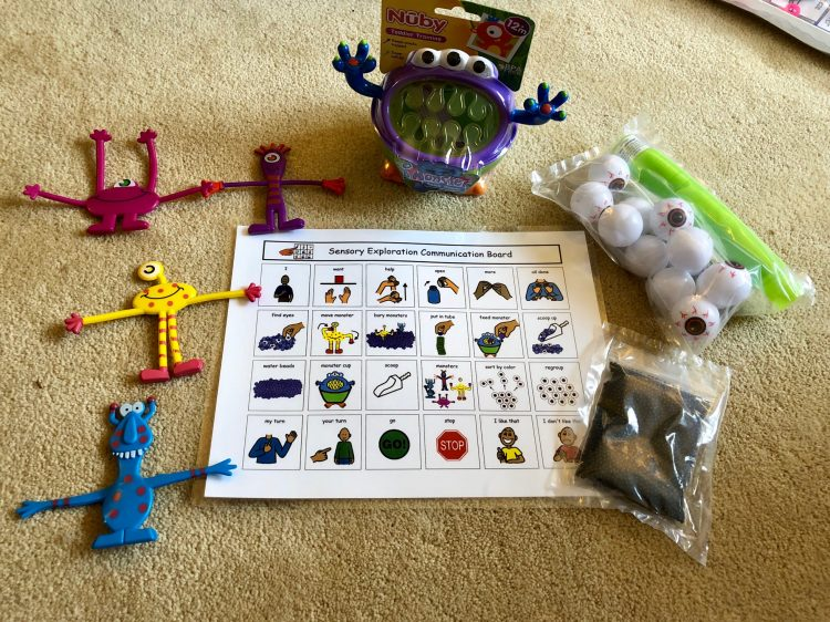 EarlyVention monster activity box, includes laminated directions with word choices, four nedable monsters, a monster cup, monster eyes, scoop and water beads